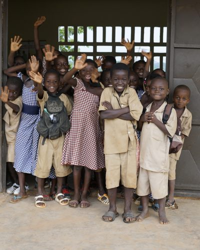 group of children from cocoa community in school