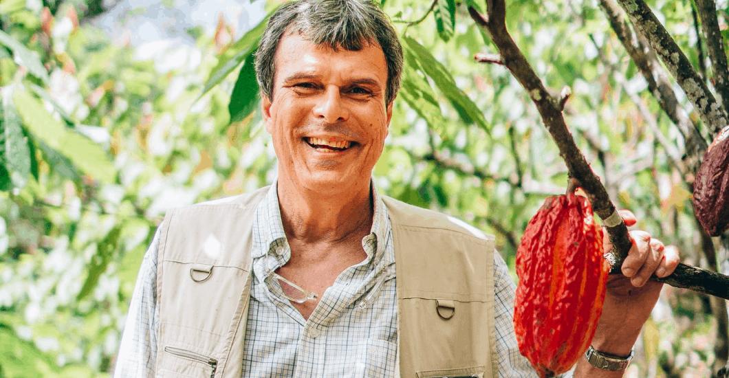 Brazilian cocoa farmer next to cocoa tree, sustainable farming, sustainable cocoa