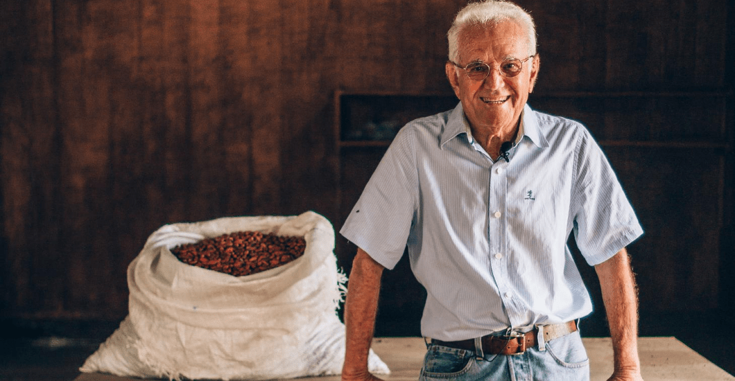 Cocoa farmer near bag of sustainable cocoa beans in Brazil