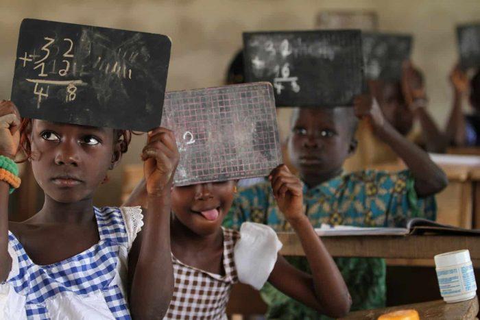 Children in a cocoa community in school