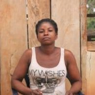 Headshot of sustainable woman cocoa farmer Janet Awuku in Ghana