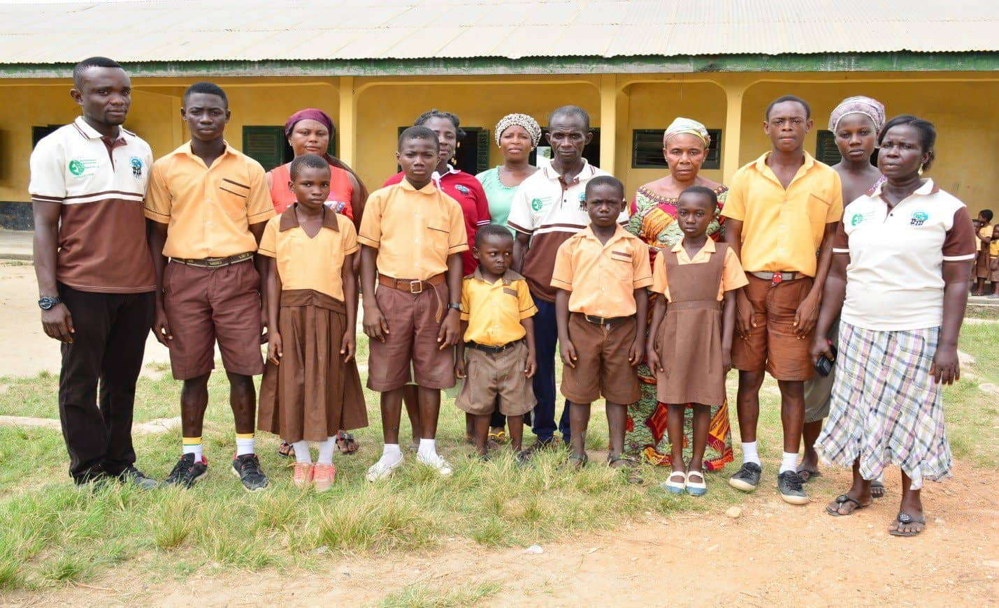 School children in uniforms and women in a sustainable cocoa community in Ghana