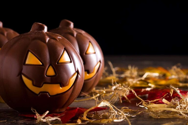 Chocolate,Halloween,Pumpkins,On,Wooden,Table.,Copyspace