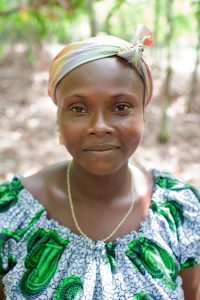 Etchi Avla, age 43, poses for a portrait on her cocoa farm in Botende, Ivory Coast on January 11th, 2013. (Photo courtesy of Oxfam)
