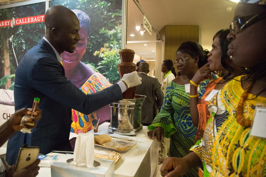 Participants visit the Trade Fair and enjoy chocolate samples. World Cocoa Foundation