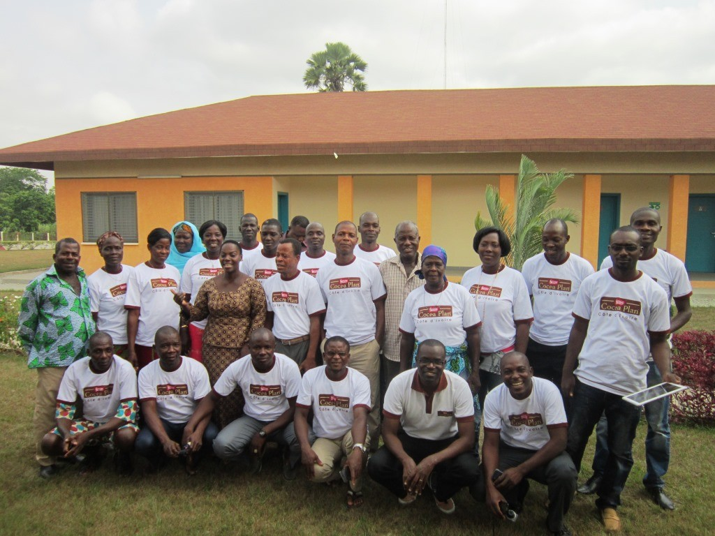 Nathan Bello,(second from the left – front row), Project Manager for Nestlé Cocoa Plan Programme in Cote D'Ivoire in group photo with female and male leaders of cocoa cooperatives and cocoa growing communities, receiving training on gender awareness at the Nestlé Research Centre in Zambakro, Cote D'Ivoire. Workshop was organized in Aug 2014.