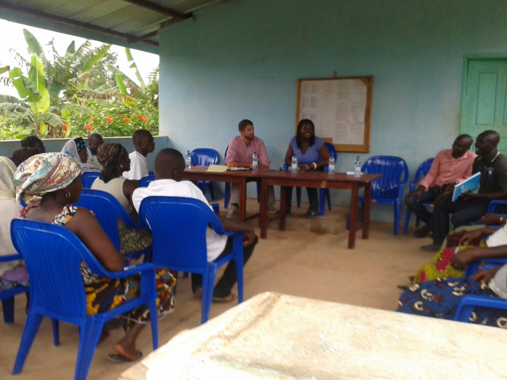 Suzanne Ngo-eyok and Ethan Budiansky, Director and Deputy Director of the Cocoa Livelihood Programme – CLP II (sitting at the table). In the company of ICRAF field staff,  a session is taking place in the village of Petite Bandoukou in the Soubre region of Cote D'Ivoire to present the benefits of the CLP II programme to female farmers and community leaders. Under its Vision for Change programme, Mars is providing assistance to female farmers with capacity building in good agricultural practices for food crops and cocoa production. The Walmart foundation grant leverages CLP II capacity building efforts that target female farmers in cocoa producing regions including Cote D'Ivoire.